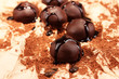 Chocolate candies with cocoa powder, close up