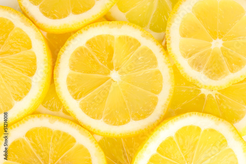 Lemon slices background © Africa Studio