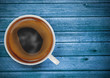 cup of coffee on blue wooden table