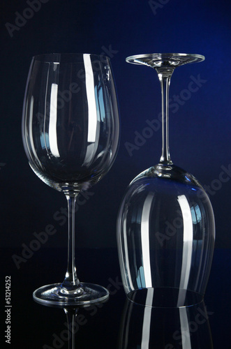 Two glasses on dark blue background