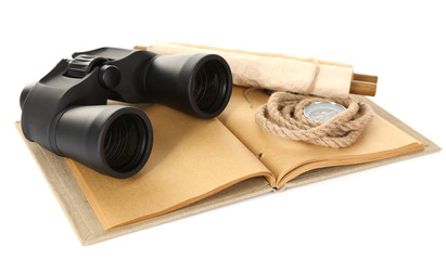 Black modern binoculars with old notebook isolated on white