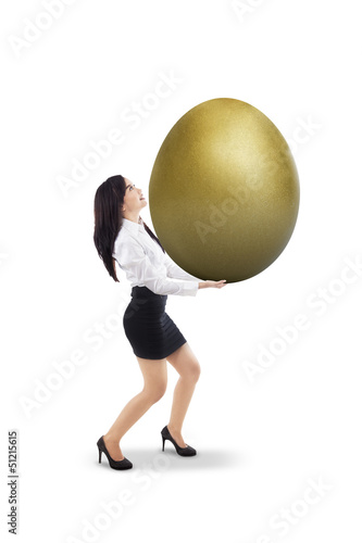 Businesswoman carry golden egg - isolated