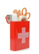 An open travel first aid kit standing on a white background