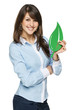 Smiling business woman holding eco leaf