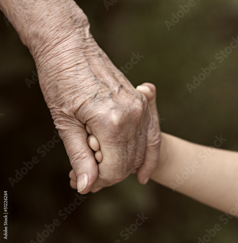 hands family grandson and old grandmother