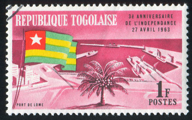 Togolese Flag and Lome Harbour