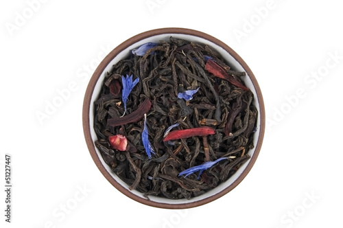 Black tea with flower petals in ceramic bowl isolated on white