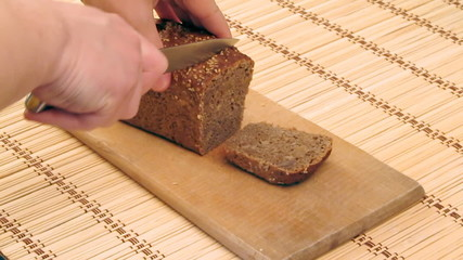 The close-up of rye-bread cutting process
