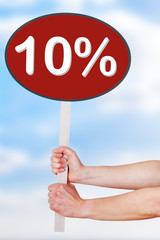 Woman hands holding sign with percentage