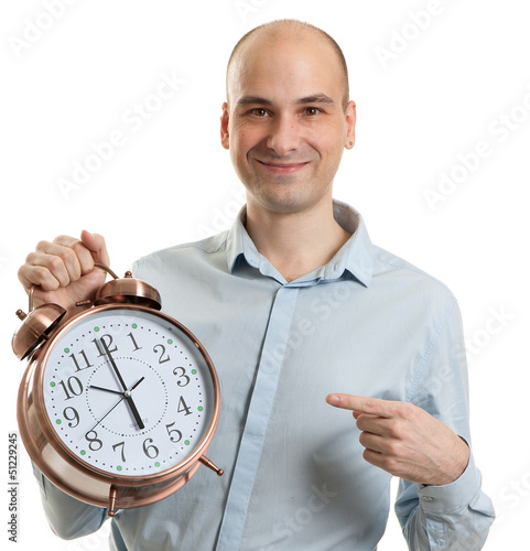 smiling guy pointing on a big alarm clock