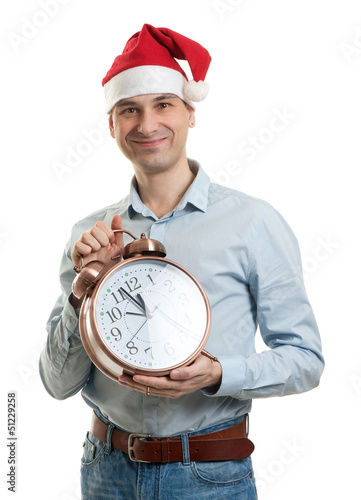 man wearing a Santa hat with big clock
