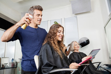 Hairdressers Setting Up Customer's Hair