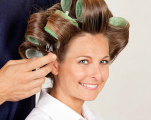 Client With Hairdresser Rolling Her Hair