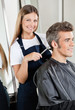 Hairdresser Cutting Client's Hair In Salon