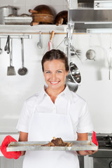 Female Chef With Tray Of Meat