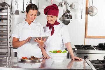 Female Chefs Using Digital Tablet