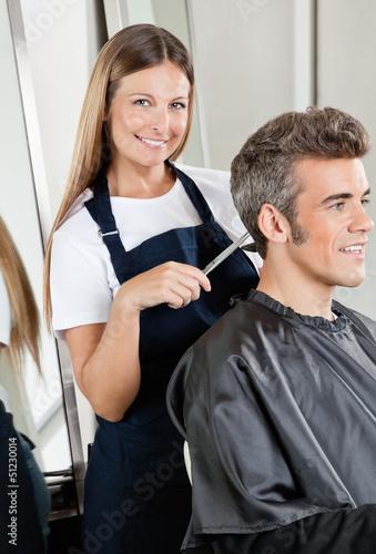 Hairdresser Cutting Client's Hair In Salon