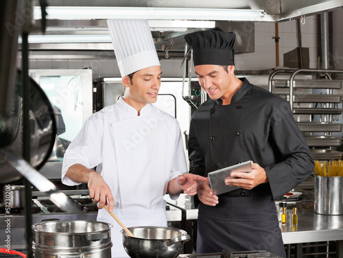 Male chefs Preparing Food Together