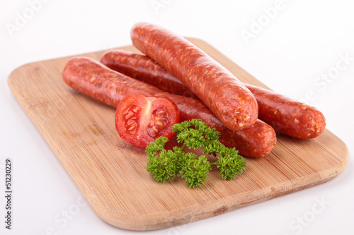 board with raw sausages