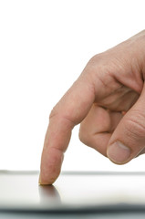 Close up of male finger working on a tablet computer