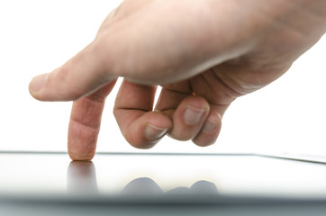 Close up of male hand using a touch screen device