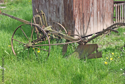 old rusty plow to work the land in Meadow Green