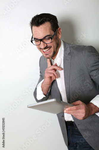 Cheerful salesman using digital tablet