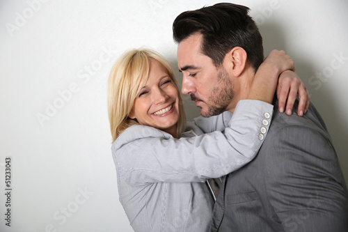 Trendy loving couple on white background