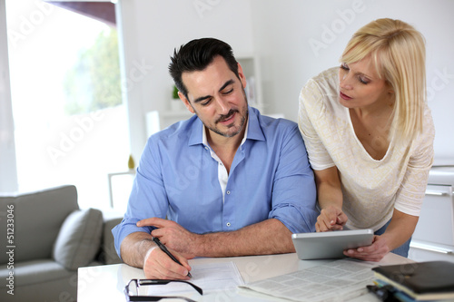 Middle-aged couple working from home