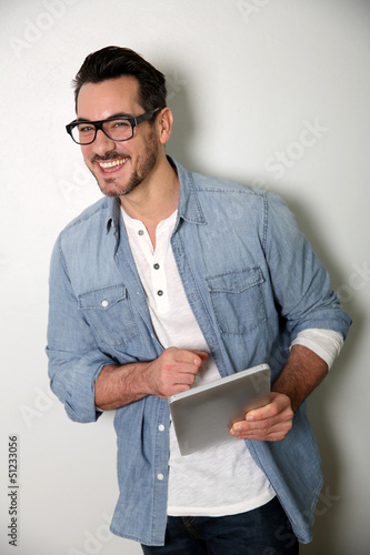 Man with eyeglasses using digital tablet, isolated
