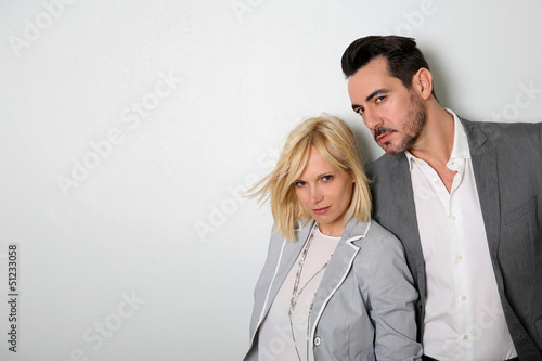 Trendy couple on white background