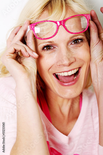 Beautiful young woman wearing pink glasses