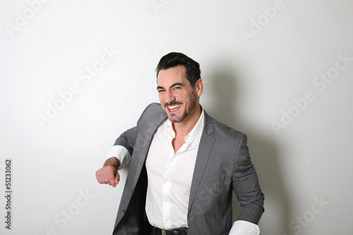 Middle-aged man standing on white background