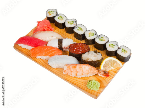 Sushi set on board isolated on white