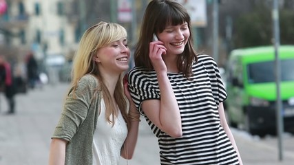 Happy girls with mobile phones