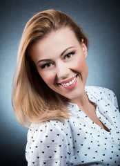 Portrait of young beautiful blond smiling