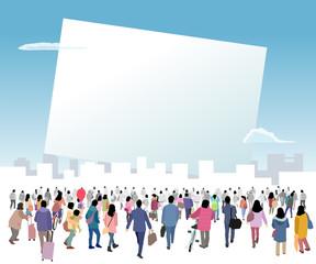 白いボードに集まる人々