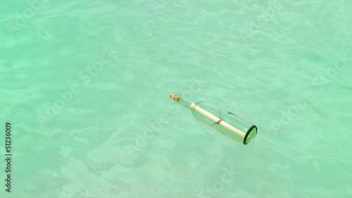 Message In A Bottle floating in Caribbean ocean, Cancun, Mexico