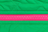 pink zipper on the green fabric
