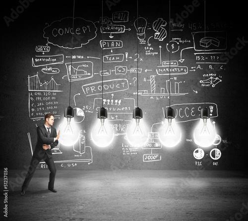 businessman pushing bulbs