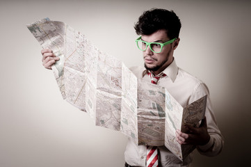 lost businessman with map