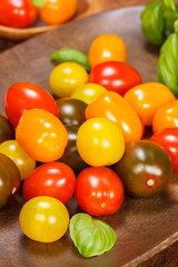 Baby plum tomatoes. Different sorts of tomatoes