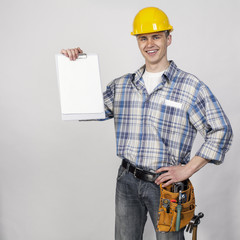 young builder with blank in hand