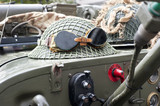 Military helmet and a pair of glasses on a jeep