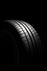 Tire on black background