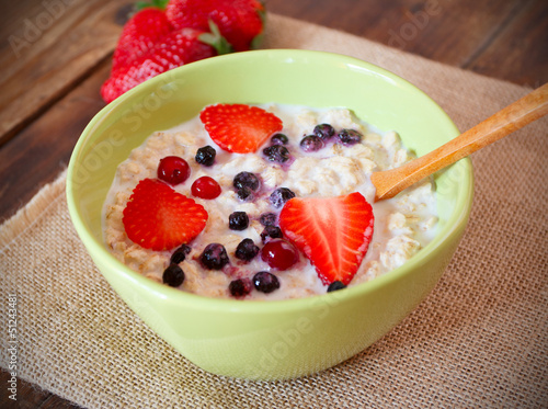 porridge with fresh strawberry, blueberries and cranberry