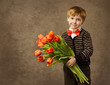 Child holding flowers bouquet of tulips, vintage style