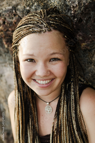 Beautiful smiling girl with brown braids
