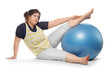Overweight woman exercising with blue ball.
