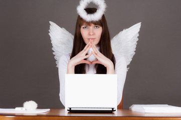 angel sitting at the computer  in the heavenly office